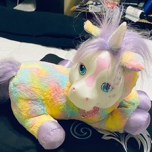 Unicorn soft an squeezable in rainbow colors